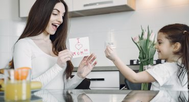 photo-of-child-showing-finger-heart-sign-to-her-mom-4149003